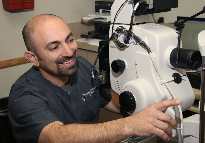 Male medical office tech preparing eye exam